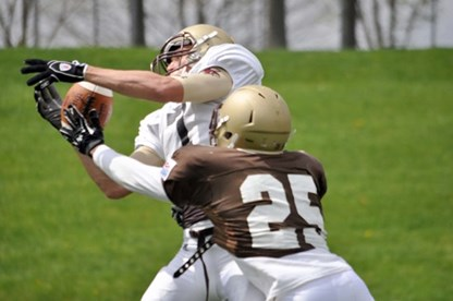 Defense's Intensity Brings Sacks, Victory in Brown/White Game, 33-19